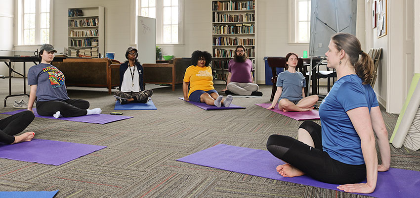 Sara Schrenk leads a yoga class at the Bethel for Honors College