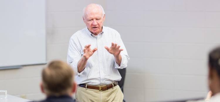 Joe Hair teaching in the classroom.