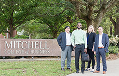 Mitchell Scholars smiling outside in front of sign