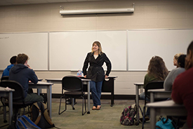 Speaker in front of class for Women in Business