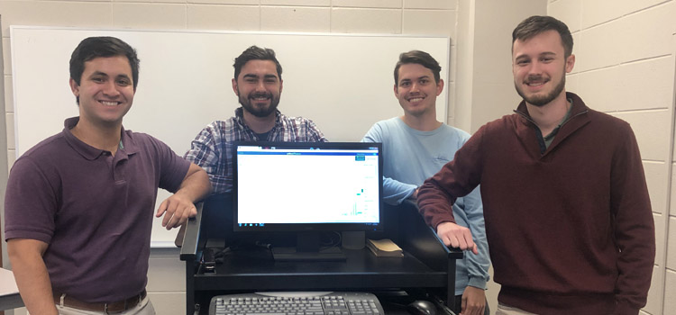 The team of four Mitchell College of Business finance students: Justin Abalos, Thomas Alford, Micah Jordan, and Garrison McGraw