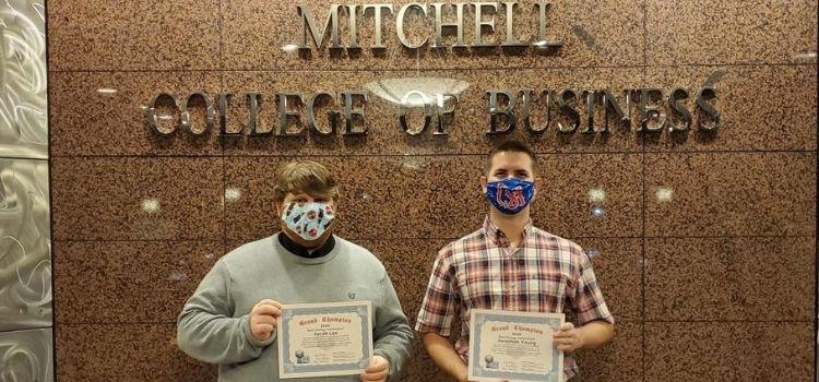 MBA students receive Grand Champion Award.