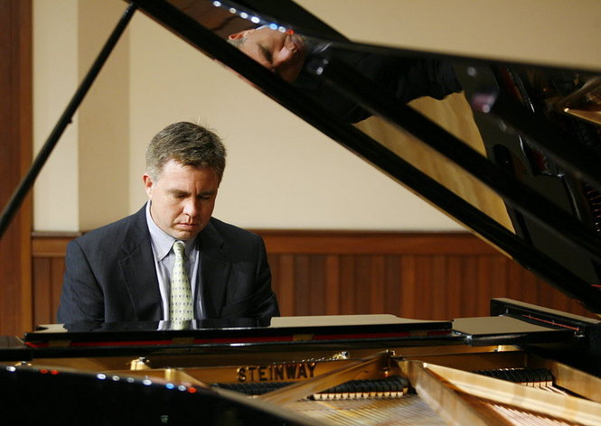 Dr. Robert Holm playing piano