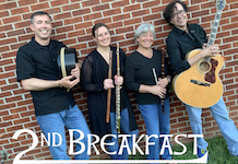 Pictured against a brick wall are members of the 2nd Breakfast Celtic Band.