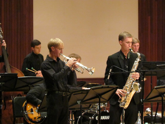 Five members of USA Jazz Ensemble as they perform on stage