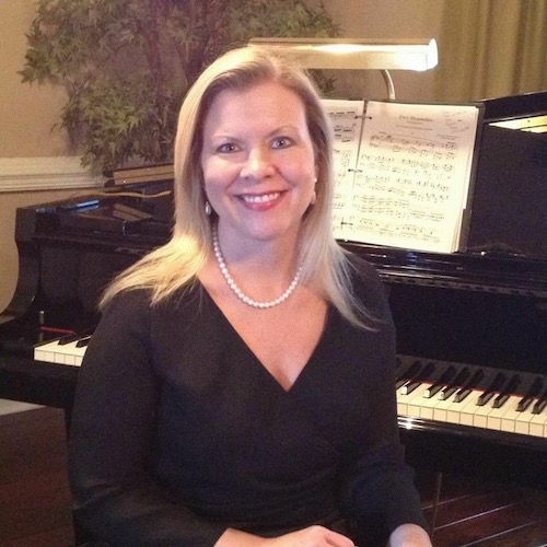 Tracy Mank seated in at piano
