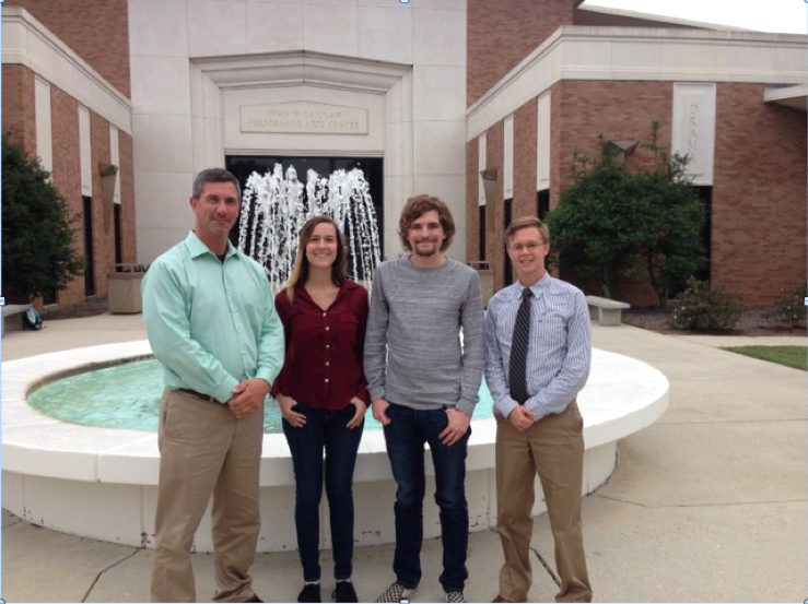 Dr. Michael Phillips (Advisor), Alyssa Weiskopf, William Jake Cannon, and Steven Reed Gilmore standing in front of fountain outside Laidlaw