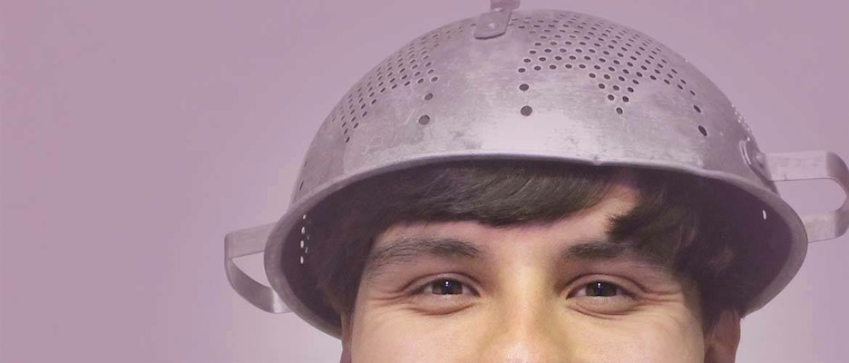 Luke Smith with metal colander on his head as a hat