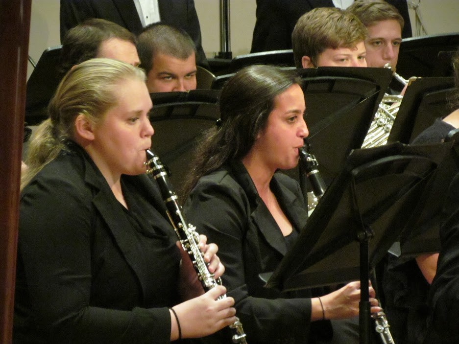 closeup of two girls playing clarinets