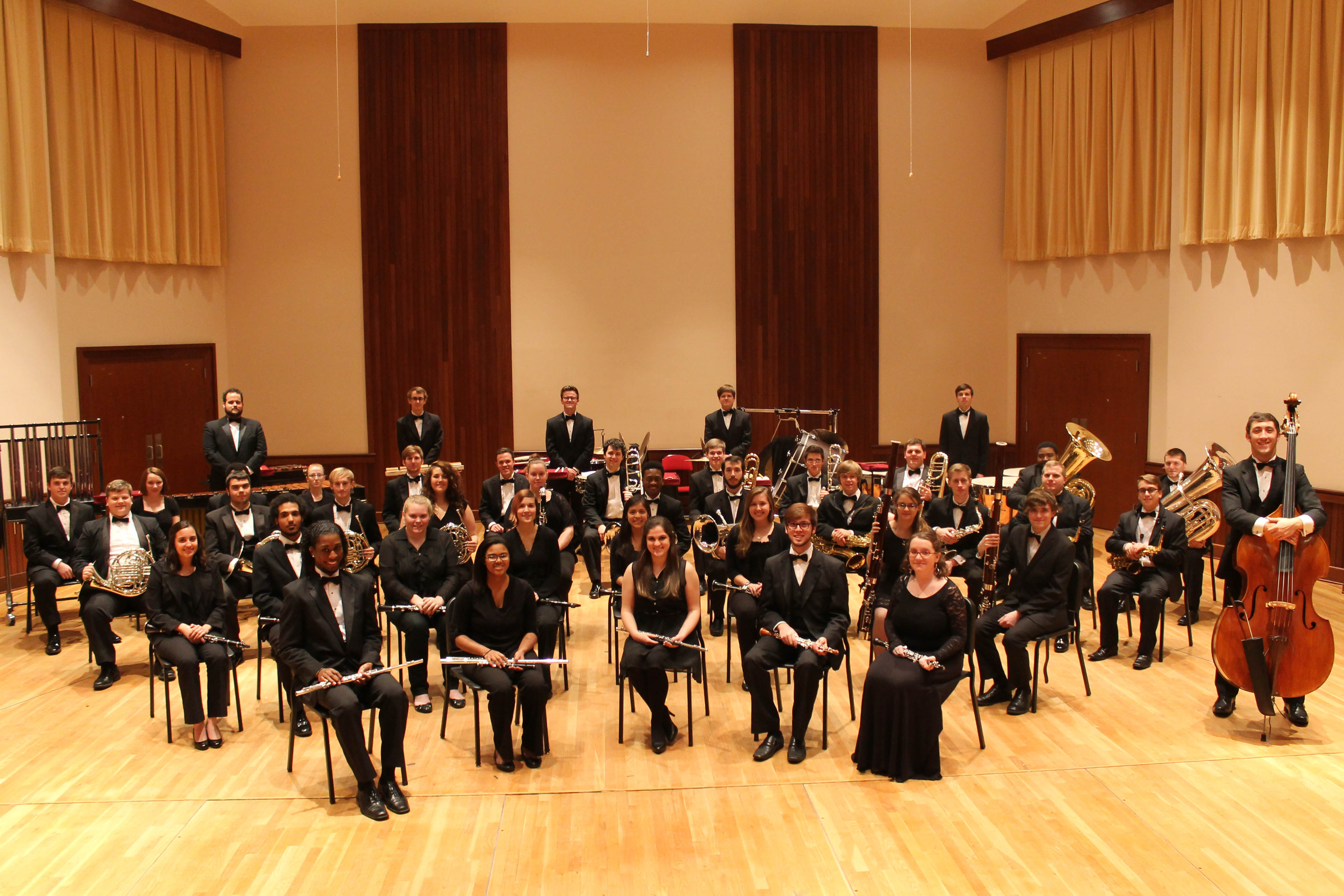 members of USA Wind Ensemble and Symphony Band on stage in before performance