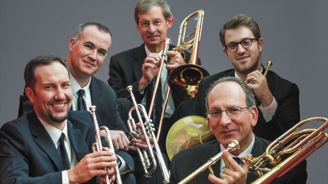 Members of American Brass Quintet posing with their instruments