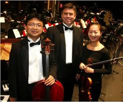 the Archduke Piano Trio, consisting of Steinway Artist and USA Professor of Piano Dr. Robert Holm, violinist Enen Yu and cellist Dr. Guo-Sheng Huang,