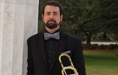 Pictured at the Greek columns on the USA campus is senior trombonist Brandon Bodie.