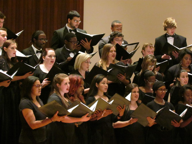 USA Concert Choir and University Chorale performing on stage