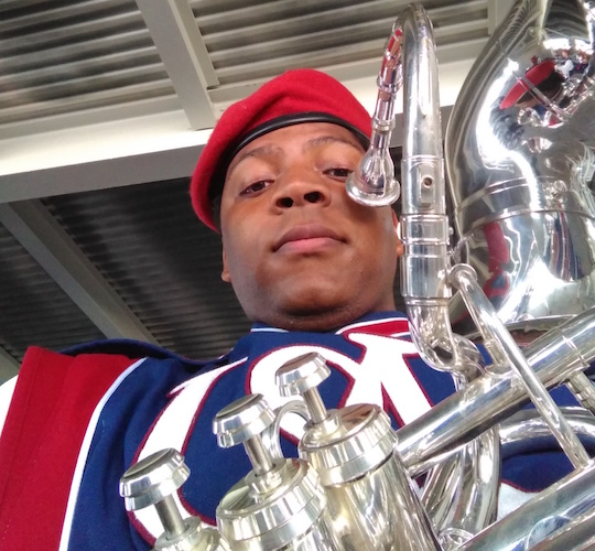 closeup of Kenneth Coleman in his band uniform holding his tuba