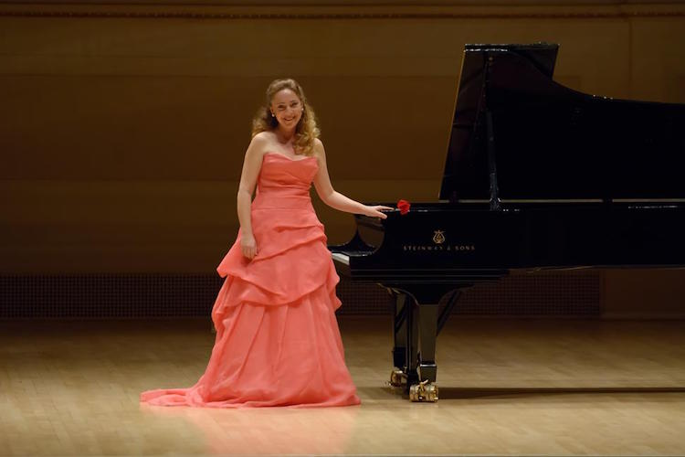 Pictured on stage is piano soloist Katya Grineva