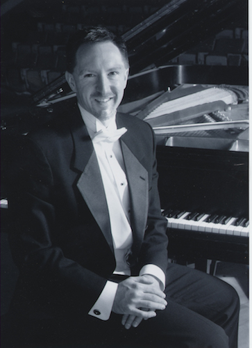 black and white of Dr. James Helton seated at piano