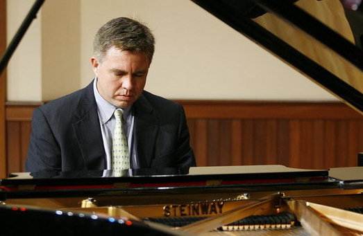 Pictured at the piano on the Laidlaw Recital Hall stage is Dr. Robert Holm.