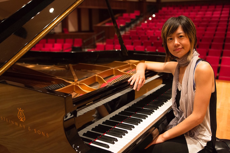 Jasmin Arakawa seated at open Steinway piano
