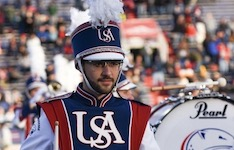 Pictured in uniform with the South Alabama Jaguar Marching Band is recently graduated senior percussionist Jared Messinger.