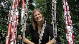 Pictured in her garden surrounded by many types of double reed instruments is Dr. Rebecca Mindock.