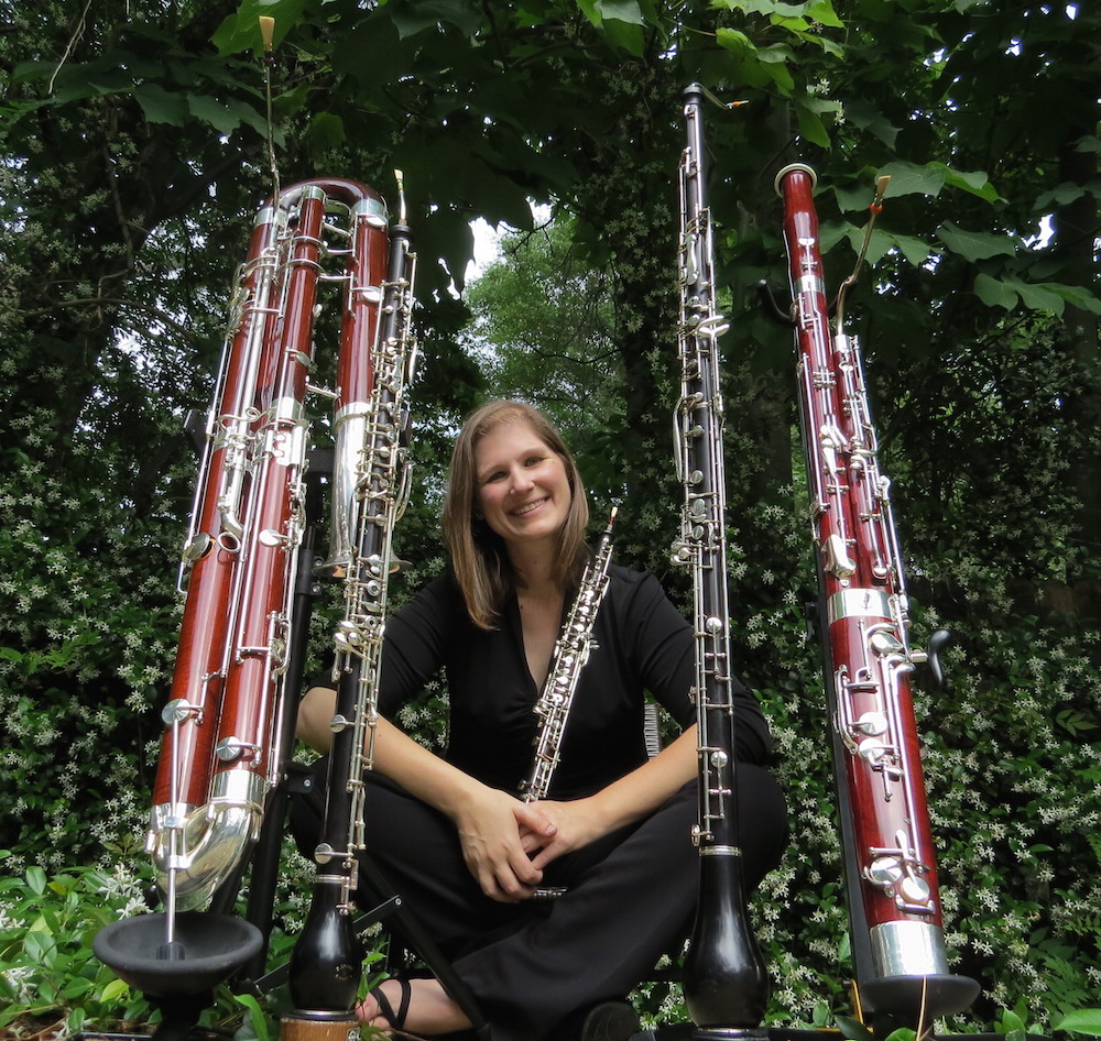 Rebecca Mindock Faculty surrounded by Double Reed instruments data-lightbox='featured'
