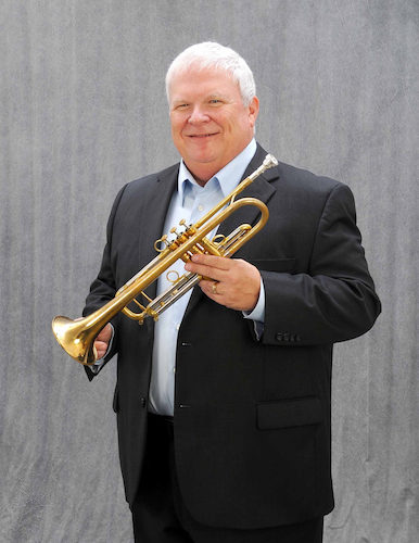 Robert Murray standing with trumpet
