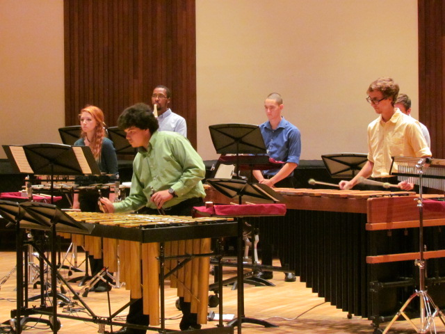 members of USA percussion ensemble with instruments on stage