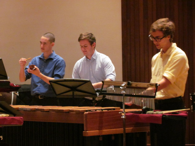 three members of USA Percussion Ensemble performing on stage