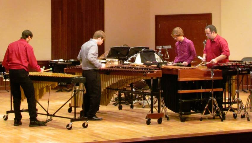 Pictured in performance are members of the USA Percussion Ensemble.