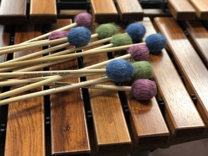 Mallets and marimba pictured to advertise percussion recital data-lightbox='featured'
