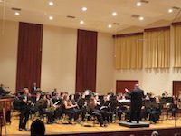 Pictured on stage in the Laidlaw Performing Arts Center Recital Hall is the USA Symphony Band.