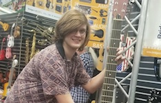 Pictured at a music business conference is senior USA student guitarist Alec Thompson.