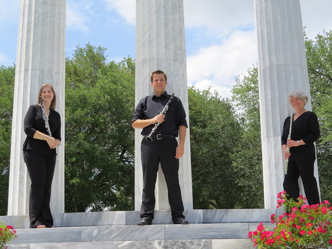 Pictured by the Greek columns on the USA campus is the Trebuchet Wind Trio. data-lightbox='featured'