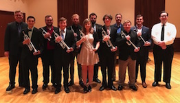 Pictured from a past performance are the students and teacher of the USA Trumpet Studio.