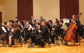 Pictured on the Laidlaw Recital Hall stage is the USA Wind Ensemble.