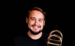 Pictured is USA faculty trombonist Dr. Arie VandeWaa.