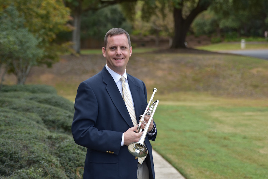 Pictured out of doors by the Laidlaw Performing Arts Center fountain is trumpeter and USA faculty Dr. Peter Wood. data-lightbox='featured'