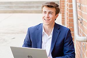 Student smiling with laptop