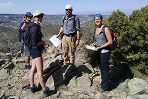 Students and professor working in the field for geology