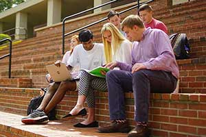 Students studying outside on campus.
