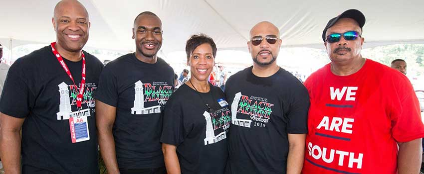 Members of the Black Alumni Society tailgating.