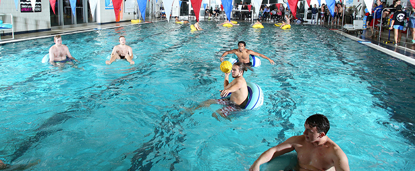 Students playing water polo in the campus rec pool