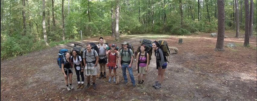 Image of group in woods with backpacks on