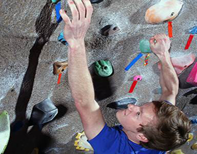 Male climbing rockwall