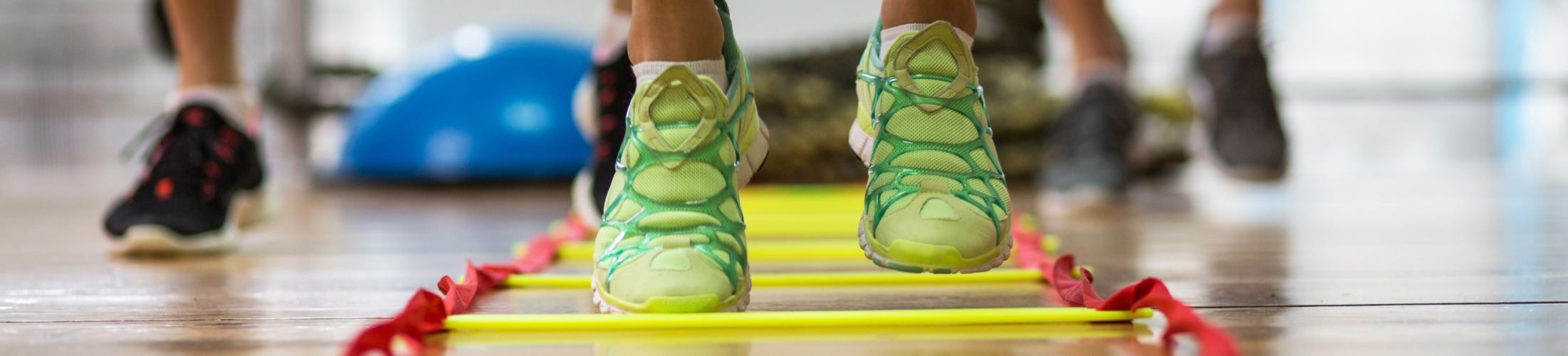 Tennis shoes running through a fitness ladder