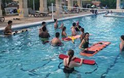 Pool with people practicing for certification.