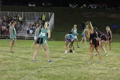 Female students playing flag football