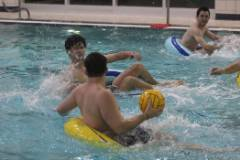 Students playing innertube waterpolo in campus rec pool
