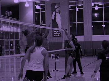 Student playing volleyball inside the rec center